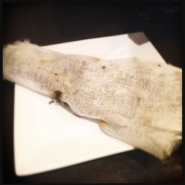 Inside this rag is a smoldering chunk of dry rosemary. Photo by Vanessa Wolf