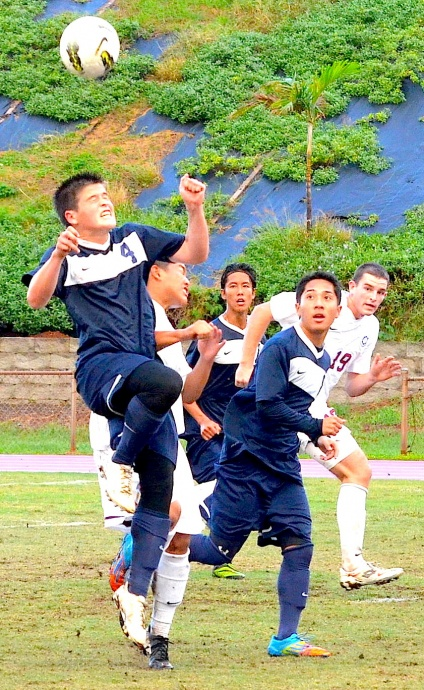 Kamehameha Maui's Micah Alo (4), shown here going up for a header in a match against Baldwin earlier this year, scored the Warriors' second goal in their 2-0 win over Mililani on Wednesday. File photo by Rodney S. Yap.