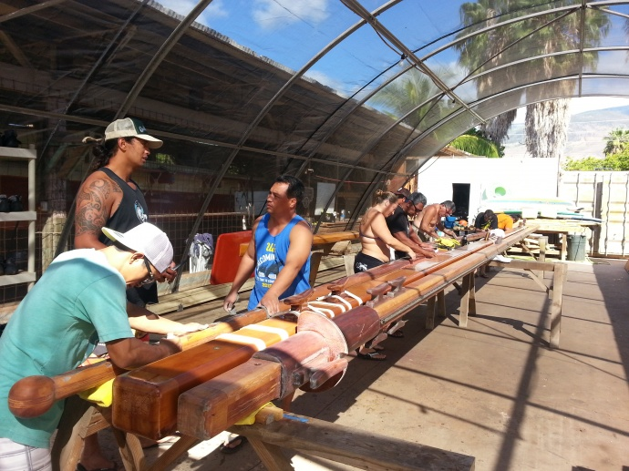 Sanding Masts for Mo'okiha. Photo courtesy Hui o Waʻa Kaulua.
