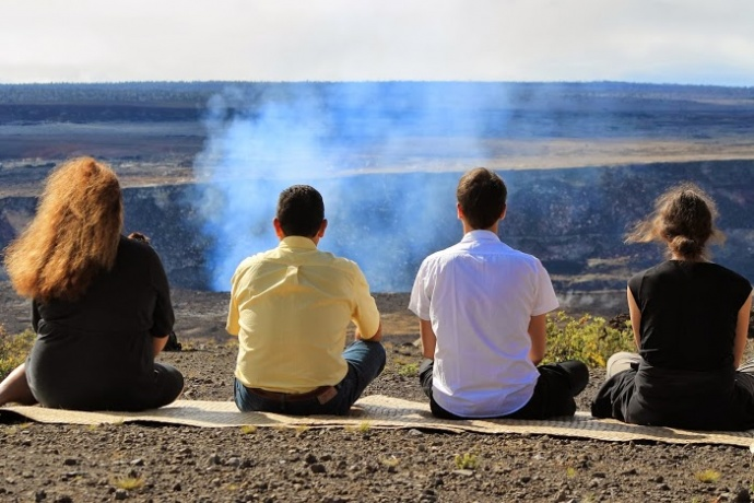 IUCN delegates contemplate the stillness and vastness of Halemaumau vent. Photo courtesy state Department of Land and Natural Resources.