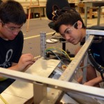 (pictured left to right) Baldwin High Robotics team members Brandon Waite and Evan Grimes work on the chassis of their robot during the 2013 FIRST season.