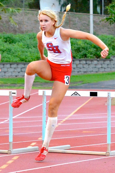 Seabury Hall's Cindy Fell finished 17th overall in the girls 100 hurdles (16.35) and 28th overall in the 300 hurdles (50.05) Saturday at the Mt. Carmel Invitational in San Diego, Calif. This photo is of Fell competing in the 300 hurdles last week at the Victorino Invitational here on the Valley Isle. Photo by Rodney S. Yap.