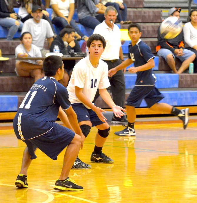 Kamehameha Maui's Walter Kaeo watches as sophomore teammate Craden Kailiehu prepares to pass this incoming serve. Photo by Rodney S. Yap.