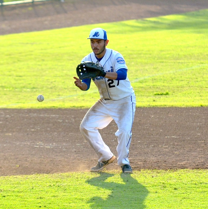 Maui High third baseman Kody Medeiros fields this grounder for an eventual putout at first base. Medeiros delivered the game-winning RBI when his single in the top of the 15th inning scored Trent Hori. Photo by Rodney S. Yap.