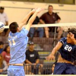 Kamehameha Maui's Keawe Rindlisbacher hits this ball past the block of Baldwin's Trent Helle in Wednesday's MIL match at Baldwin's Jon Garcia Gym. Photo by Rodney S. Yap.
