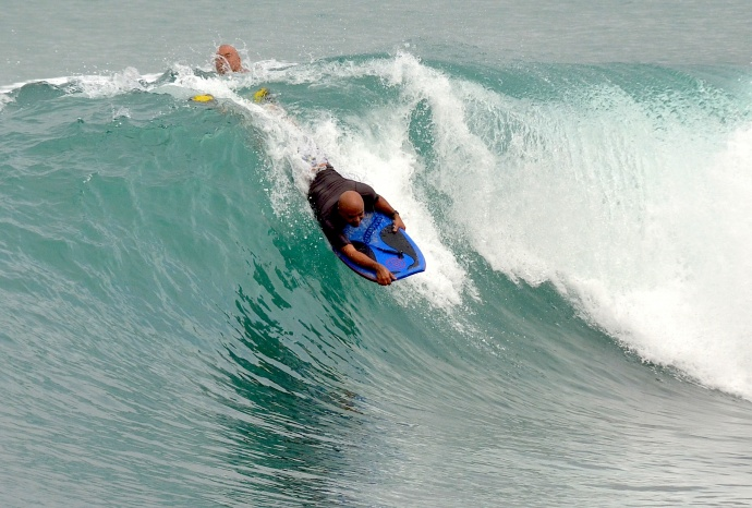 An unidentified bodyboarder enjoys the surf in Kahului Harbor Saturday brought on by a swell that hit the north shore over the weekend. Photo by Rodney S. Yap.