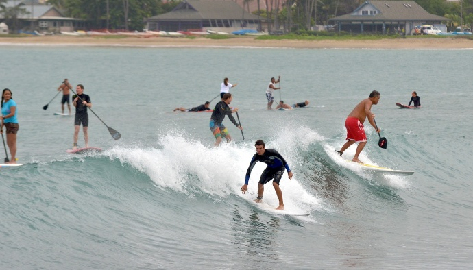 Men and women, surfers, standup-paddle boarders, bodyboarders, and kayakers all shared the waves inside Kahului Harbor Saturday afternoon. Photo by Rodney S. Yap.
