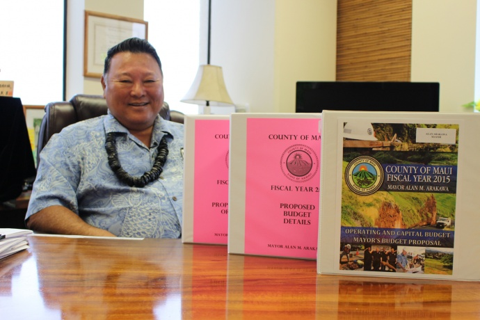 Maui Mayor Alan Arakawa with his version of the Fiscal Year 2015 Budget. Photo by Wendy Osher.