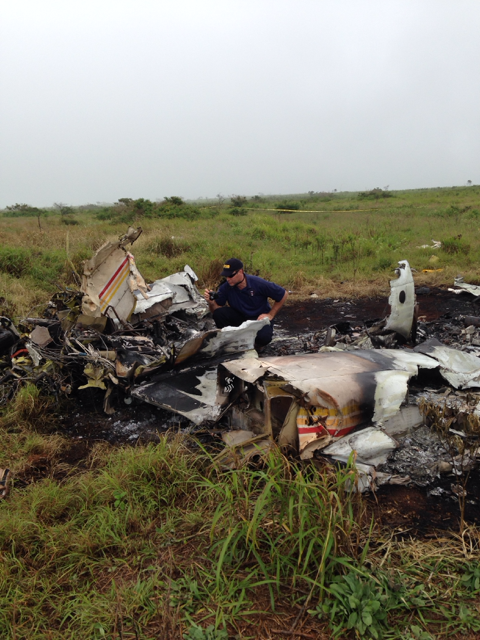 NTSB investigator Andrew Swick documents the wreckage of a Piper PA-31 that crashed in Lanai, HI, on Weds. Feb. 26. Photo courtesy NTSB.