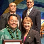 Photo Courtesy of Sen. J. Kalani English: Senators Gilbert Keith-Agaran (top left),  J. Kalani English (top right) and Roz Baker (bottom right) present Anthony Kamakaʻeu Williams (bottom left), 2014 Maui School District Teacher of the Year, with a congratulatory certificate from the Hawaiʻi State Senate.