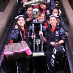 Hawaii All-Star Cheerleaders from L4 Small Seniors Division arrived at Kahului Airport Monday with the championship hardware from the prestigious NCA All-Star National Championships in Dallas, Texas. Photo by Ben Juan.