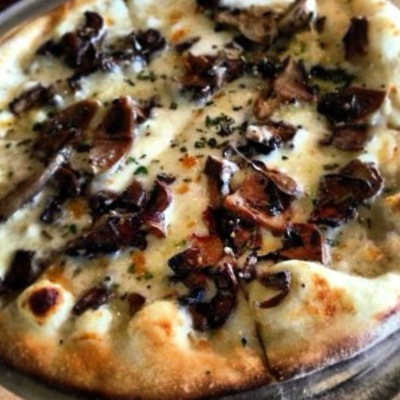 The Hamakua Wild Mushroom & Truffle Pizza. Photo by Vanessa Wolf