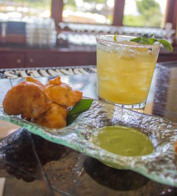 Makena's 'Something PHO You' cocktail with Crab and Lobster Corn Fritters Photo courtesy Makena Beach & Golf Resort