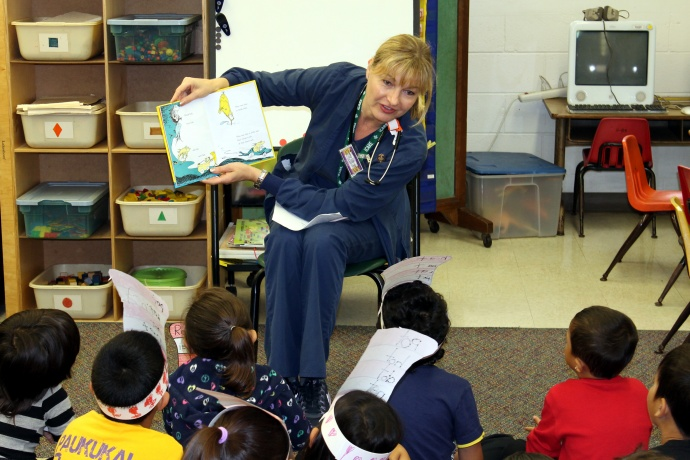 Leslie Lexier, RN, Quality Specialist reads to the class for Read Across America. Photo courtesy HHSC Maui Region.
