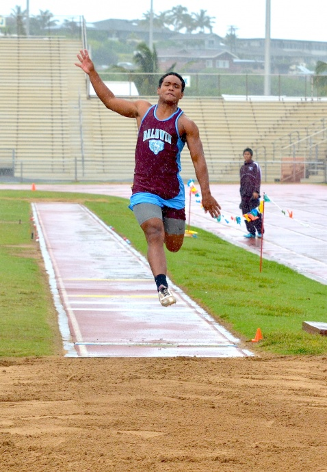 Baldwin's Keenan Lewis jumps in the rain of the boys long jump Saturday at the MIL Yamamoto Invitational Track & Field Meet. Lewis finished fourth in the event. Photo by Rodney S. Yap.