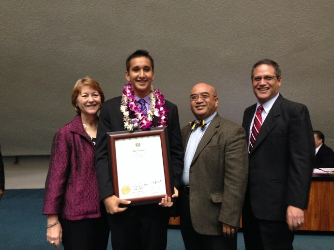 Mason Aquino (second from left) with Maui Senators. Photo courtesy of the Senate Communications Office.
