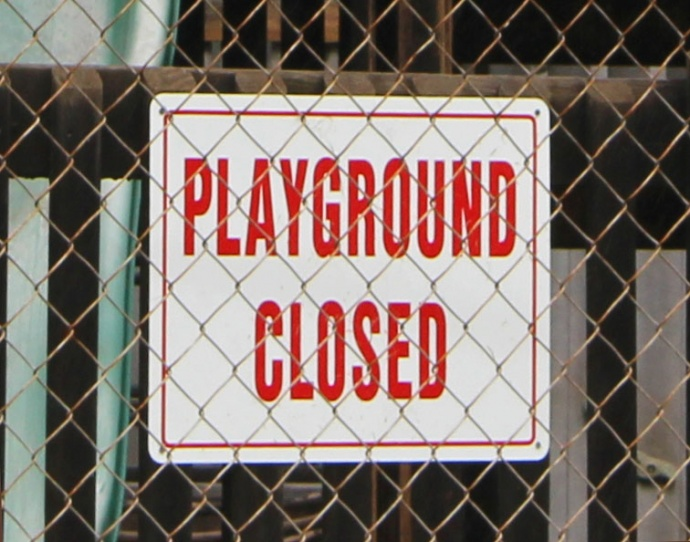 Playground closed sign at Kalakupua, Giggle Hill, Fourth Marine Division Park. Photo by Wendy Osher.