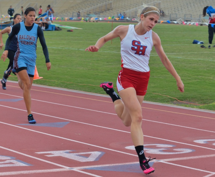 Seabury Hall's Alyssa Bettendorf winning the girls 100-meter dash in 12.16 seconds. Photo by Rodney S. Yap.
