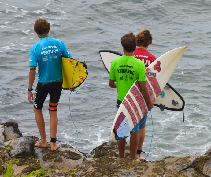 Competitors in the boys shortboard semifinals prepare to get wet at Ho'okipa Beach Park on Saturday. Photo by Rodney S. Yap.