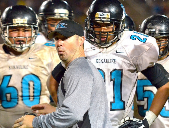 King Kekaulike head football coach Kyle Sanches talks to the defense during a timeout last season. File photo by Rodney S. Yap.