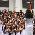 Madison Vaught raises the ihe as her senior classmates celebrate.  Photo by Rachel Kanoho.