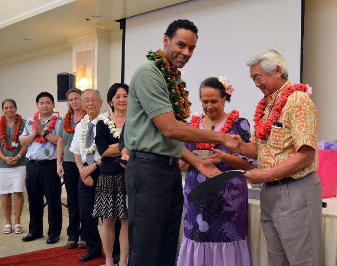 Graduating Fellow Akili Jones accepts his certificate from Chancellor and Steering Committee Memeber Clyde Sakamoto. Courtesy photo.