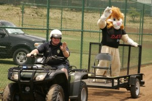 DARE Officer Tim Hodgens and Darren the DARE Lion. Photo courtesy Maui Police.