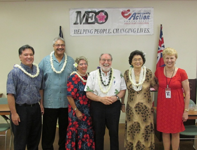Governor Neil Abercrombie (center) joins Maui Economic Opportunity Board Officers after presiding at their installation ceremony. (From left to right) are Kevin Yoshida, Vice-president, Kai Pelayo, President; Adele Rugg, Secretary; May Fujiwara representing Cliff Alakai, Treasurer; and Lyn McNeff, MEO's Chief Executive Officer. Courtesy photo.