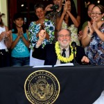 Governor Neil Abercrombie signs House Bill 2560 while on Maui. Courtesy photo.