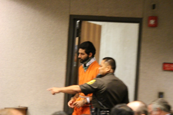 Upon entering the courtroom, Capobianco was dressed in an orange uniform issued by the Maui Community Correctional Center, and was wearing handcuffs and a neck brace.   July 15, 2014. Photo by Wendy Osher.
