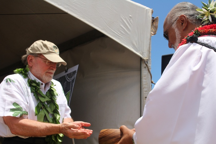 Groundbreaking of the Central Maui Regional Sports Complex, July 31, 2014. Governor Neil Abercrombie (left) washes his hands prior to the blessing led by Pastor Laki Kaʻahumanu (right). Photo by Wendy Osher.