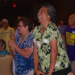 Left to right Agnes Groff, Kaui Alo-Palau and others enjoy the song Burn'n Love performed by Darren Lee as Elvis .