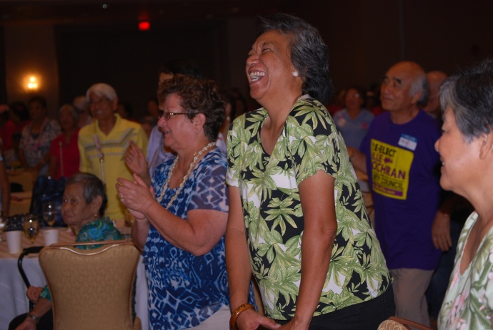 Left to right Agnes Groff, Kaui Alo-Palau and others enjoy the song Burn'n Love performed by Darren Lee as Elvis at the Maui Senior Fair. Courtesy file photo (2014).