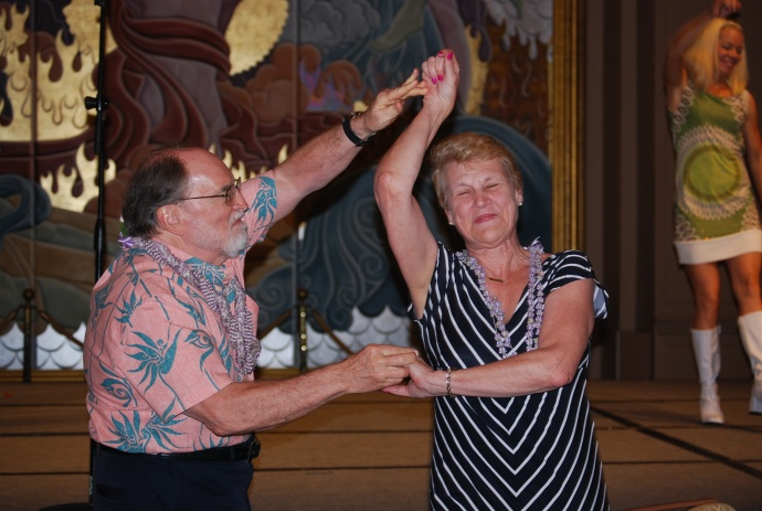 MEO CEO Lyn McNeff and Governor Neal Abercrombie dance to Burn'n Love.