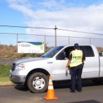 A police officer confronts a driver over an uncovered load on his truck during a 2010 demonstration. Courtesy file photo.
