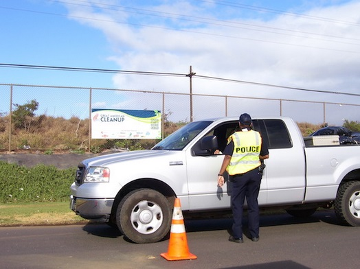A police officer talks to a driver about laws relating to uncovered loads during a 2010 educational campaign. Courtesy file photo.