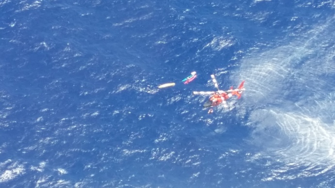 The Coast Guard rescued eight people after their vessel sank near Kaiwi Channel, Molokai, Aug. 3, 2014. An MH-65 Dolphin helicopter crew from Coast Guard Air Station Barbers Point hoisted the persons from the water and transported them to Sandy Beach Park where members from the Honolulu Fire Department were waiting. (U.S. Coast Guard photo)