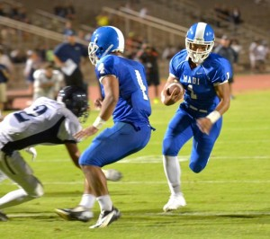 Maui High running back Soane Vaohea (1) runs inside the lead block Onosai Emelio (4) for a 12-yard touchdown run in the second quarter Thursday at War Memorial Stadium. Photo by Rodney S. Yap.