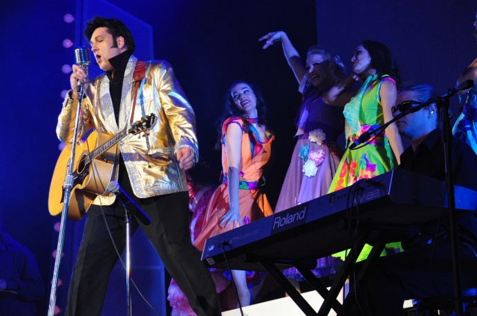 "Darren Lee as Elvis sings ""Hound Dog"" with dancers and band. Courtesy photo."