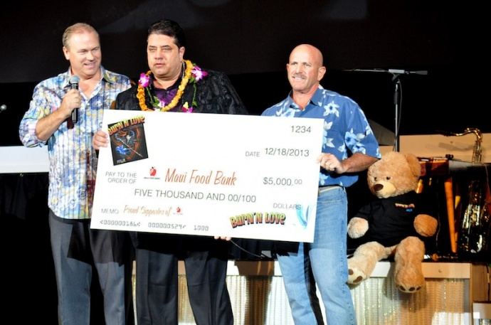 (L to R) Burn'n Love General Manager, Rick Dunaj and Executive Producer Mike Kattawar present $5,000 donation to Maui Food Bank Executive Director Richard Yust in December 2013. Courtesy photo.
