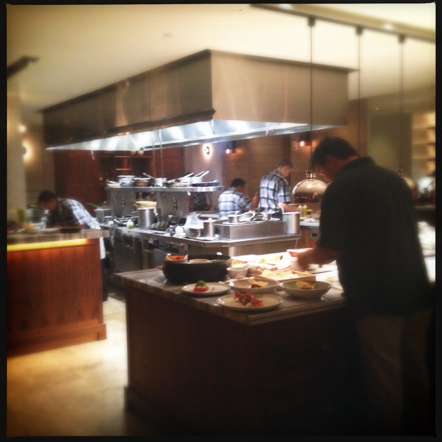 The open kitchen line greets you as you walk in the door. Photo by Vanessa Wolf