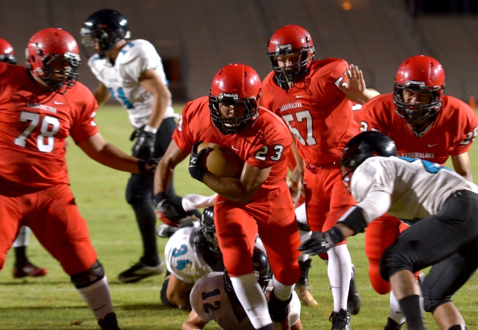 Lahainaluna's Jared Rocha-Isalas (23) scores one of his two short-yardage touchdown runs Friday against King Kekaulike. Helping pave the way for the Lunas' running back is lineman  Justin Hong (78). Photo by Rodney S. Yap.