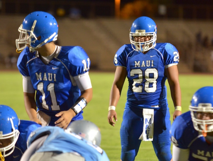 Maui High junior running back Daniel Kelley (28) rushed for 216 yards and one touchdown on 28 carries Friday against Kealakehe at War Memorial Stadium. Photo by Rodney S. Yap.