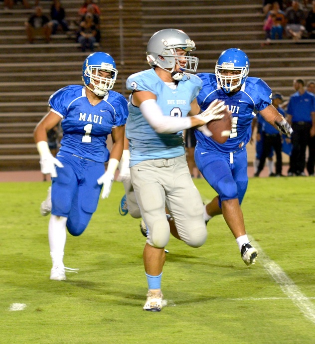 Maui High's Soane Vaohea (1) and Atunaisa Vainikolo (71) are in hot pursuit of Kealakehe quarterback Kaimi Wilson (3) during second-half action Friday at War Memorial Stadium. Photo by Rodney S. Yap.