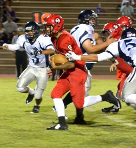 Lahainaluna's Makoa Filikitonga finds his way through the Kamehameha Maui defense Saturday en route to the second of his two rushing touchdowns. The Lunas' quarterback also threw for two touchdowns as Lahainaluna defeated KS-Maui, 48-18. Photo by Rodney S. Yap.