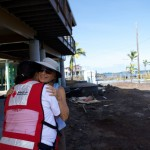 Red Cross volunteer with an affected resident on Hawaiʻi Island. Courtesy photo.