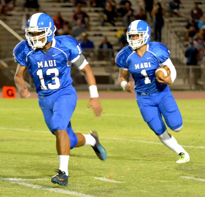 Maui High running back Soane Vaohea (1) runs behind the block of teammate Lusitania Tongi (13) against Baldwin on Friday. Vaohea finished with 53 yards on seven carries. Photo by Rodney S. Yap.
