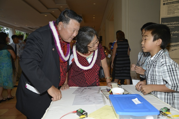 Mayor Alan Arakawa and his wife, Ann, listen to Pukalani Elementary School 5th-graders David Ho and Ryan Siarot talk about their STEM project on display during the Ke Alahele Education Fund Dinner. Pukalani Elementary's STEM program is one of dozens funded by Ke Alahele over the years.