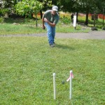 A visitor enjoys `ulu maika (lawn bowling) in Kipahulu during a recent cultural demo. Courtesy photo.