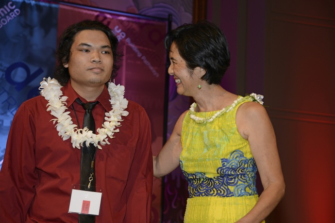 AJ Ramelb (left) said he was surprised when Maui Economic Development Board President and CEO Jeanne Skog announced he had won the Daniel K. Inouye Innovation Award at the Ke Alahele Education Fund Dinner Saturday night at the Grand Wailea Resort. Ramelb, a 2014 King Kekaulike High School graduate, was recognized for using technology in the campus STEMworks™ lab to design a paintbrush grip for special needs students.